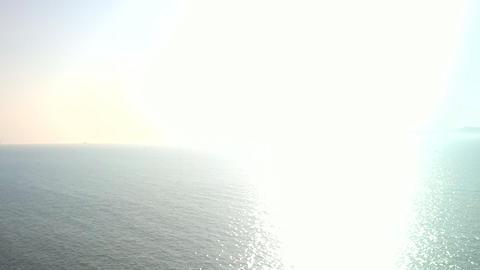 Dazzling sunrise. Sun rises over sea Footage