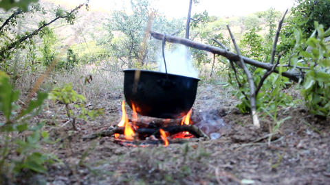 Bivouac. Cooking on fire during hike Footage