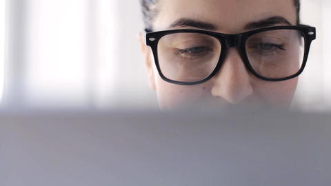 young woman in eyeglasses with tablet pc at home Footage