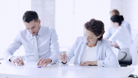 man and woman signing a contract Footage