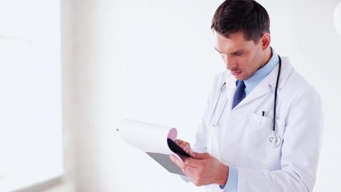 male doctor making a prescription Footage