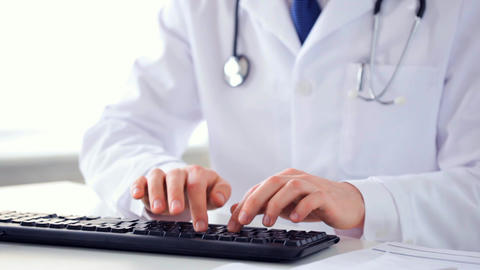 male doctor hands typing on keyboard Footage
