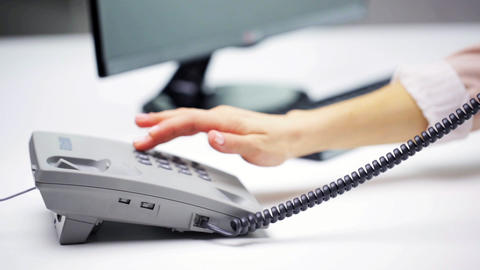 woman hand dialing number on telephone at office Footage