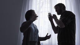 Quarrel of a young family, conflict concept, domestic violence, window in the Footage