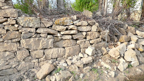 classic stone wall, old stone wall, demolished wall Footage