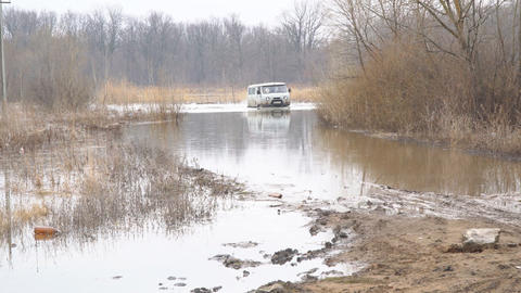 Off-road car is wading through a spilled river Footage