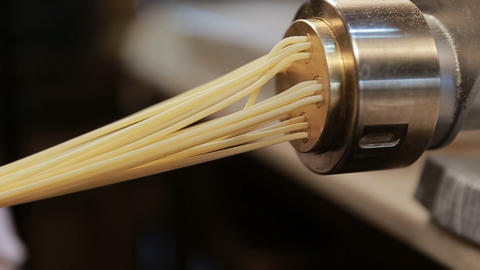 Making noodles with pasta machine from homemade spelt dough Footage