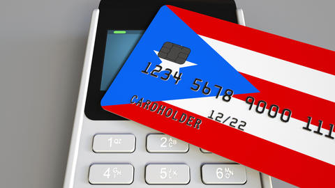 Payment or POS terminal with credit card featuring flag of Puerto Rico. Retail Footage