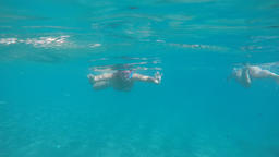Woman approaching swimming and snorkeling on a beach with turquoise waters, slow 영상물