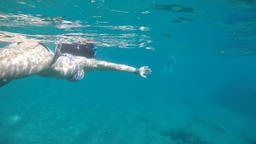 Happy girl swimming and snorkeling on a beach with turquoise waters, slow 영상물