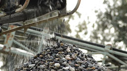 Stones and pebbles conveyor putting down pebbles in a mountain in a sand quarry Footage