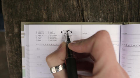 Girl writing three exclamation marks near the word Monday Footage