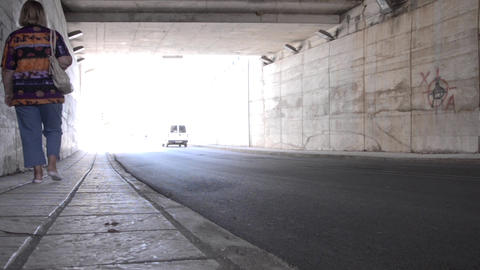 Auto and pedestrian traffic in an underpass which goes under a freeway 61 Footage