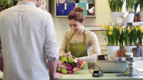 florist woman with flowers and man at flower shop Footage