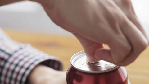 hand opening lemonade or soda drink can Footage