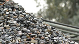 Pebbles and stones falling in a pebbles mountain in a sand quarry Footage