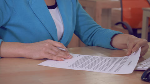 female signing documents Footage