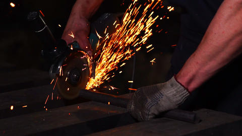 closeup on electric saw and hands of worker with sparks. man working with Footage