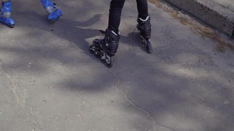 Two boys riding on roller skates Footage