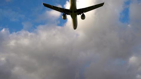 Airplane landing at illuminated runway Footage