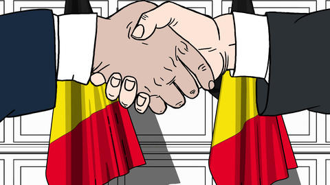 Businessmen or politicians shake hands against flags of Belgium. Official Footage