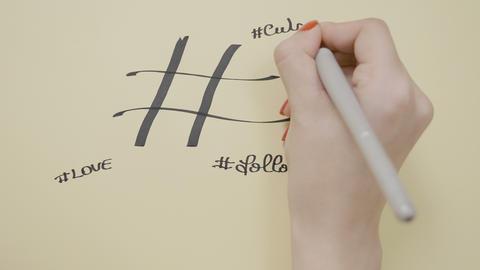 Social media influencer female hands writing hashtag cool life cute follow Footage