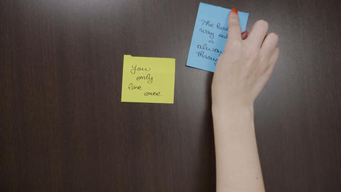 Young depressed woman sticking handwritten post it with... Stock Video Footage