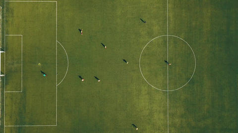 Aerial view of football team practicing at day on soccer field in top view 영상물