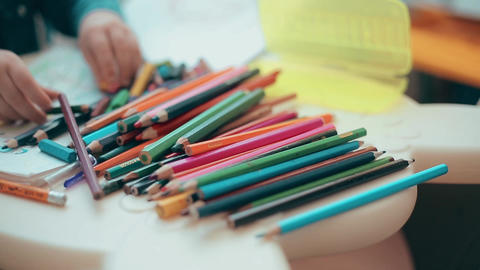 Little boy learns to draw with colored pencils and crayons Footage