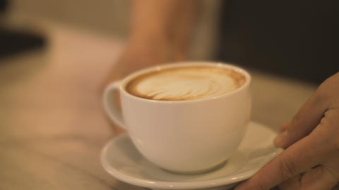 Barista putting prepared coffee cappuccino cup on table in cafe close up Footage