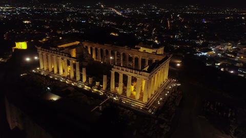Aerial night video of iconic ancient Acropolis hill and the Parthenon at night Live Action
