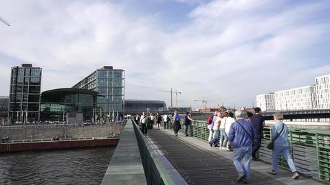 People Walk Gustav Heinemann Bridge, Spree River, Berlin, Germany Footage