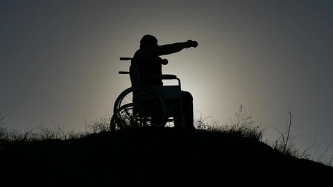 disabled man in wheelchair making gym excercise silhouette slow motion 영상물