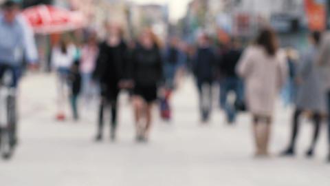 Blurred people walking on street in weekend Footage