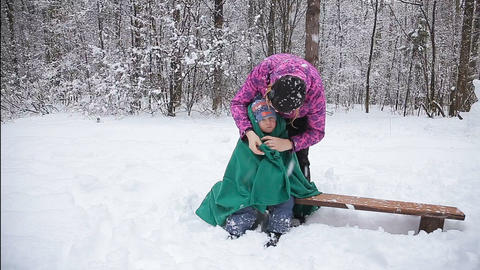 Winter fun, snow, happy children at winter time. Happy mother and son playing wi Footage