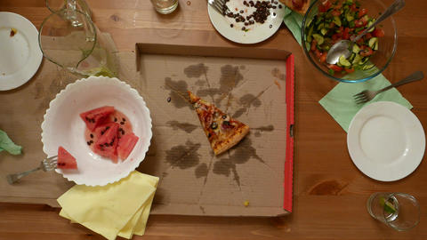 Man hand take last piece of pizza, top shot, small wooden table Footage