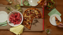 Pizza On Table For Three People, Man Take One Piece Of Warm Snack stock footage