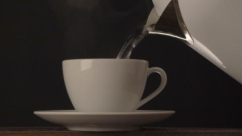 Pouring Hot Water From Electric Kettle stock footage
