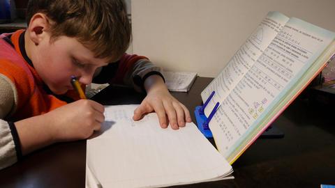 School Boy Doing Homework Footage