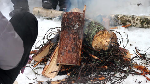 Kindling of fire from sticks and logs Footage