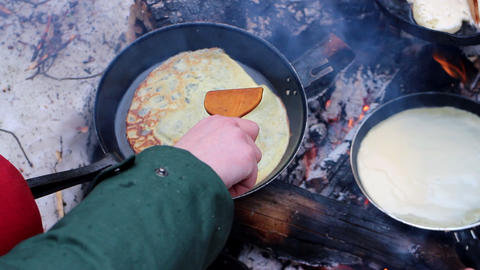 Traditional food 2. Russian cuisune: pancakes over an open fire Footage