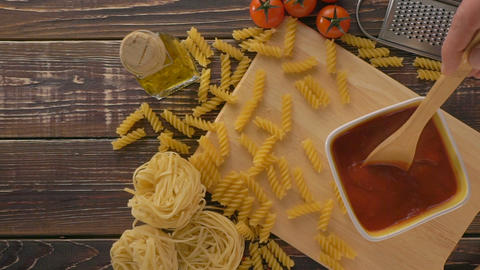 Pasta And Ingredients On The Wooden Table stock footage