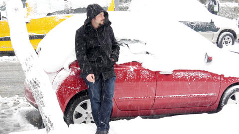 Helpless man waiting rescue, Car stuck under snow, snowy day Footage