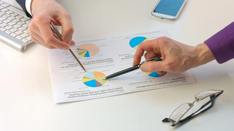 Male hands pointing at paper containing data about economic situation Live Action