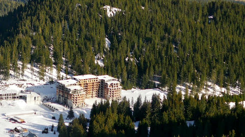 Panning left to right over winter ski resort of Pamporovo. Mountainous area with GIF