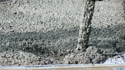 Pouring concrete mix on concreting formwork. Forming, an essential part of the Footage