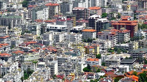 Zoom out. Urbanization landscape of Housing in Alanya city center. Dense Footage