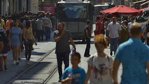Armored police car patrols along in the crowded Istiklal Street. Heavily armed GIF