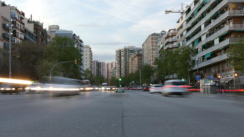 Blurred traffic in Barcelona at dusk.Time Lapse.Trail effect. Long exposure Footage