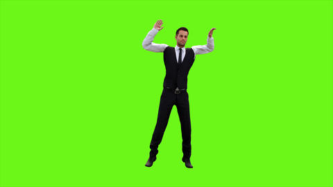 Young businessman dancing after a successful transaction on a green screen GIF